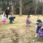 Children search the green of the First Congregational Church of Stockbridge for Easter eggs