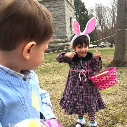 A young girl shows off her Easter egg basket