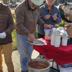 Volunteers from the First Congregational Church of Stockbridge dish out chili