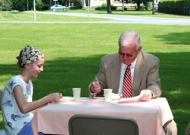 a father and daughter enjoy a laugh at the Strawberry Social at the First Congregational Church of Stockbridge