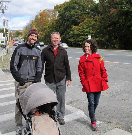 Pastor Brent of the First Congregational Church of Stockbridge, his husband Jon, and a young female congregant walking on Main Street, Great Barrington