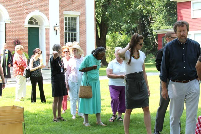 people line up for strawberries in front of the First Congregational Church of Stockbridge