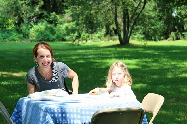 a mother and daughter enjoy the sunshine and the strawberries at the First Congregational Church of Stockbridge