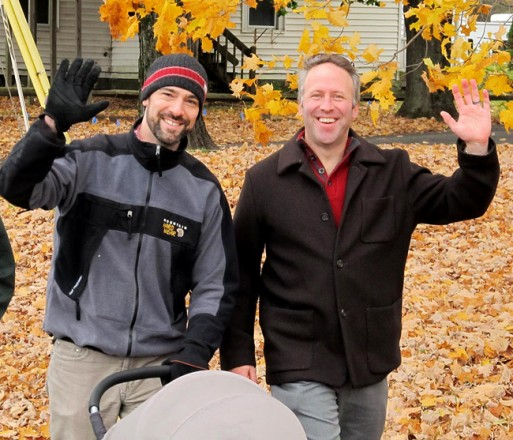 Pastor Brent and his husband Jon from the First Congregational Church of Stockbridge waving during the Construct WALK 2014